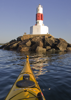 kayak and light house